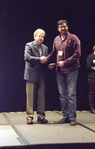 Handshake of presenter and recipient