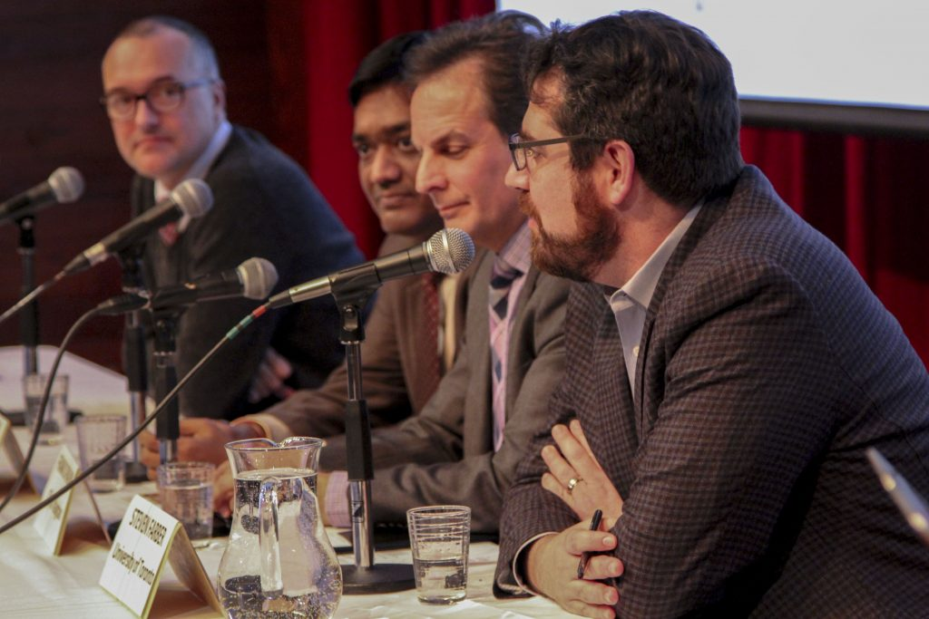 four panelists at table with microphones