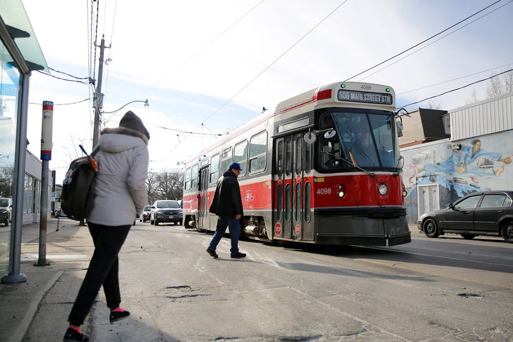 Two passengers board a streetcar