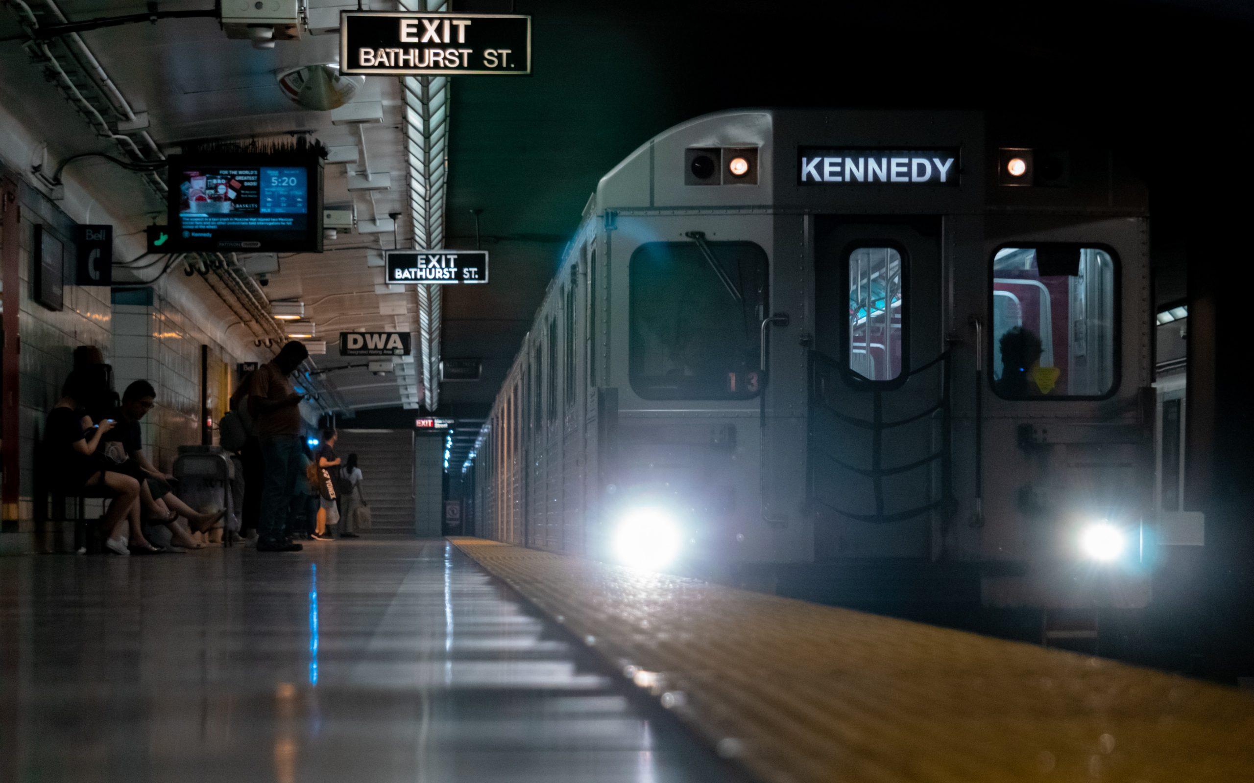 train arrives at Toronto Bathurst subway station