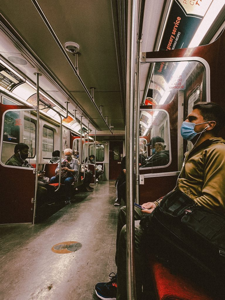 TTC subway car with masked passengers during COVID